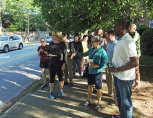 Neighbors walk with transportation professionals on Monroe Drive