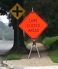lane closed ahead sign