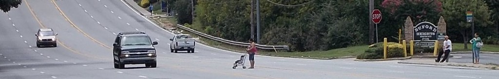 Mother pushing stroller while crossing Buford Highway