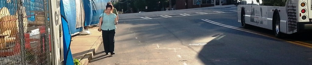 Woman walking adjacent to closed sidewalk on Peachtree Place