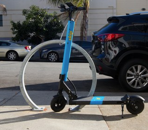 """Lock-to"" device attaches e-scooter to parking rack"